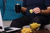 Mindless Snacking, Overeating, Lack Of Physical Activity, Laziness, Homebody. Fat Overweight Man Eng poster
