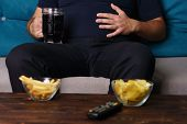 Overeating, Sedentary Lifestyle, Bad Habits, Food Addiction, Eating Disorders. Fat Overweight Man Si poster