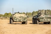 Group Of Soldiers On Tanks On The Outdoor On Army Exercises. War, Army, Technology And People Concep poster