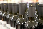 Row Of Wine Bottles, Selective Focus. Winery Background, Alcohol Shop poster