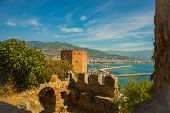 Kizil Kule Tower. City View From The Top Of The Fortress Wall: Red Tower, Port, Lighthouse, Ships, P poster
