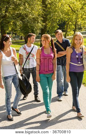 Students walking to school teens happy campus group youth friends