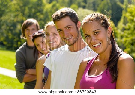 Teens smiling in the park campus students friends schoolyard leisure