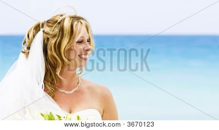 A Bride Smiling On The Beach