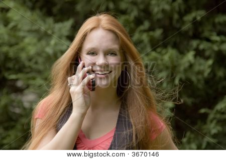 Girl On Phone With A Big Smile