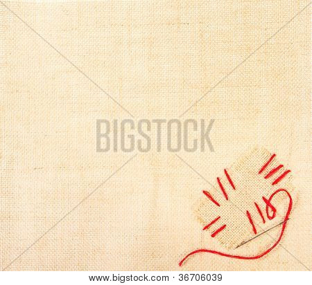 Canvas With Stiched Patch And Needle Over Burlap Background. Sackcloth Label With Copy Space