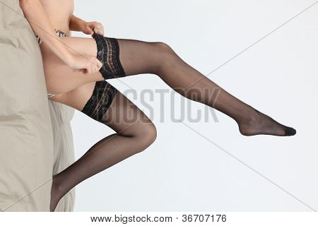 A cropped picture of a woman legs.