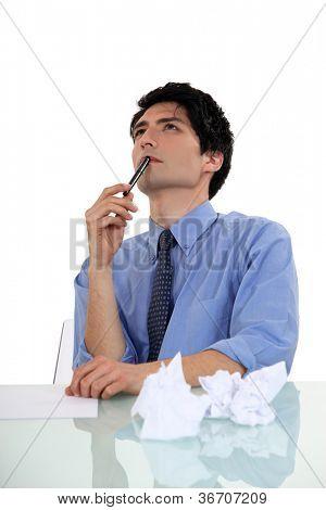 businessman writing and thinking