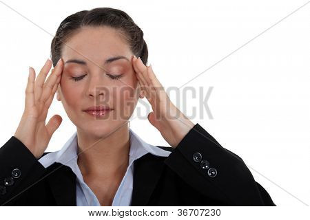 Businesswoman with tension headache