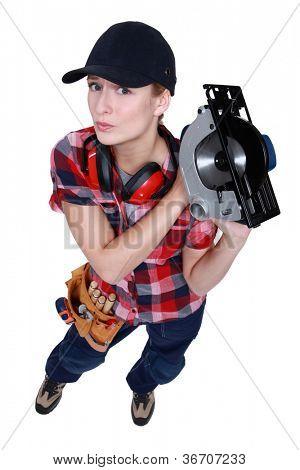 Female carpenter wielding circular-saw