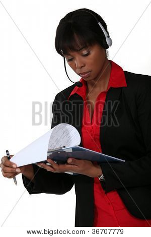 Call-center supervisor with clip-board and pen