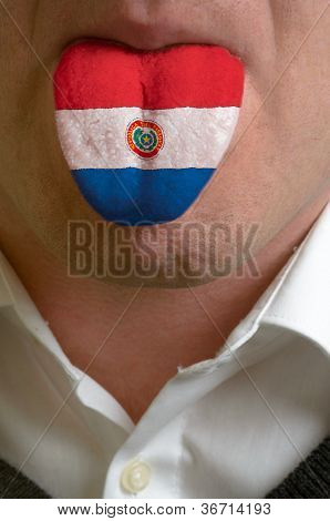 Man Tongue Painted In Paraguay Flag Symbolizing To Knowledge To Speak Foreign Language