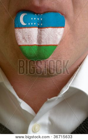Man Tongue Painted In Uzbekistan Flag Symbolizing To Knowledge To Speak Foreign Language