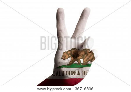 California Us State Flag Two Finger Up Gesture For Victory And Winner Symbol Made With Hand