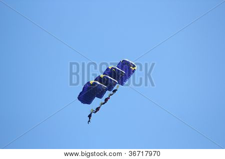 Parachutists In Formation Of Four