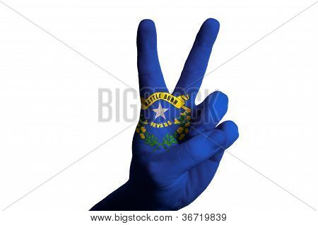 Nevada Us State Flag Two Finger Up Gesture For Victory And Winner Symbol Made With Hand