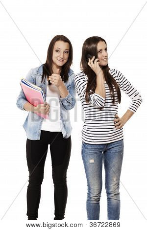 teenager showing thumb up while her friend is on the phone
