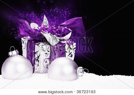 purple christmas present in snow