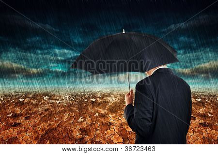 Businessman In Rain