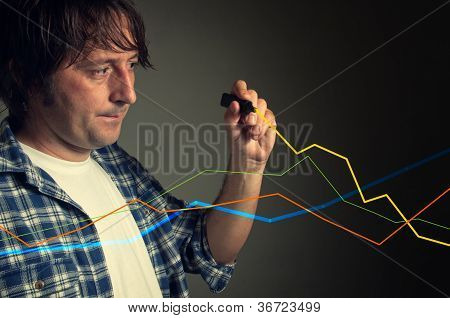Casual Man Drawing A Rising Chart