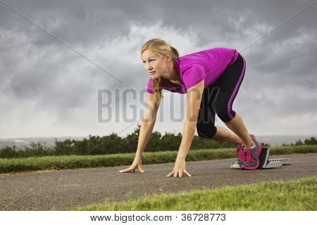Fit Middle-Aged Female Ready to Sprint