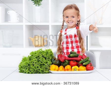 Healthy nutrition base, the vegetables approved by happy little girl