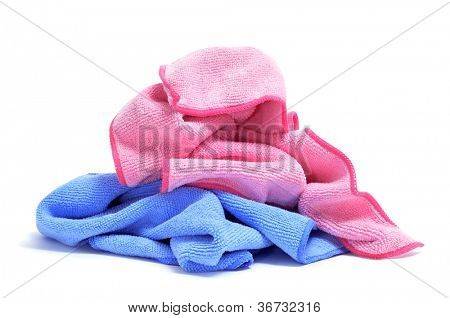 some microfiber dishcloths of different colors on a white background