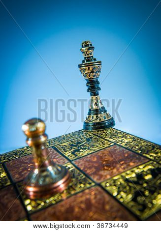 chess checkmate on a blue background