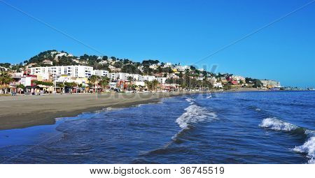 MALAGA, SPAIN - MARCH 12: El Palo Beach on March 12, 2012 in Malaga, Spain. This beach, about 1,200 meters long and 25 meters width, is full of beach restaurants where typical pescaito frito is served