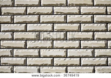 Wall from a white brick as a building or construction background