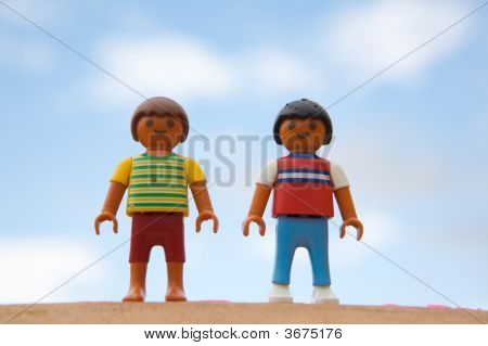 Two Dolls Standing
