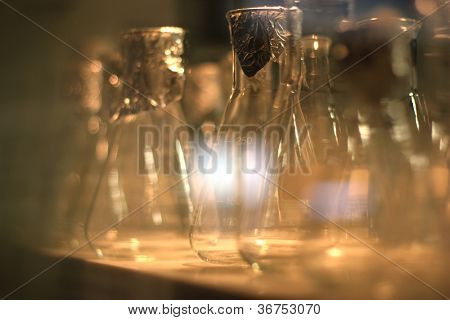 Laboratory blank glassware reflections on table