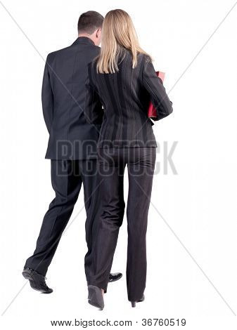 Back view of walking business team. Going young couple with books. girl and guy in suit go get an education. Rear view people collection. backside view of person. Isolated over white background