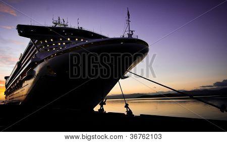 Cruise ship docked in Ushuaia at sunrise