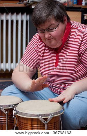 Mentaly Disabled Woman With Drums