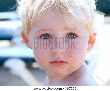 Portrait Of Young Girl Or Toddler On Beach