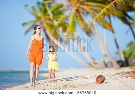 Beautiful mother and daughter on a deserted island