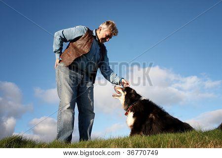 Mature Man And A Sheep Dog