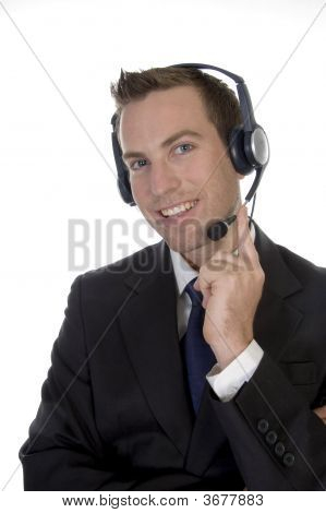 Young Man Calling With Headset And Smiling