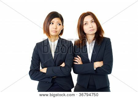 Two female office worker who express dissatisfaction