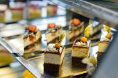 pic of bakeshop  - Cake and pastry in window display canteen food dessert tasty - JPG
