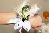 picture of senior prom  - a young girls hand with a beautiful corsage before the prom - JPG