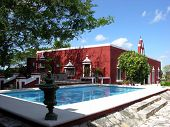 pic of hacienda  - The view of historic XIX century hacienda with a pool in Mexico - JPG