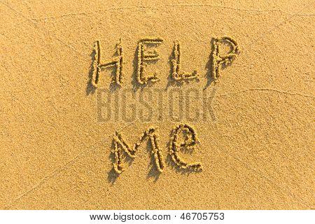 Inscription Help Me - on the sand of tropical beach.