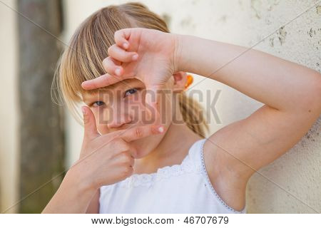 Young Girl Doing Picture Frame Sign