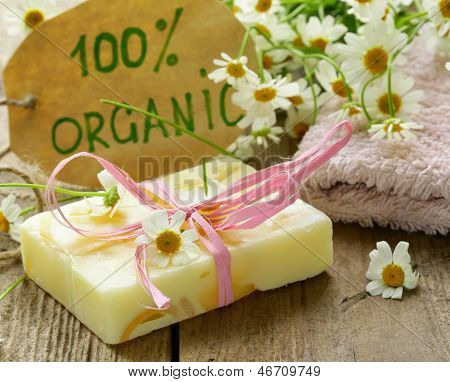 handmade soap with flowers on the organic background