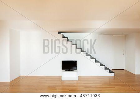 Interior, wide loft, staircase, hardwood floor