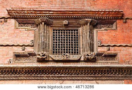 Carved wooden window on Hanuman Dhoka old Royal Palace, Durbar Square in Kathmandu,  Nepal.