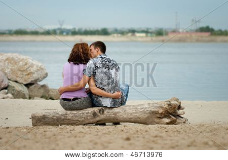 Loving Couple Is Kissing At Sea Beach