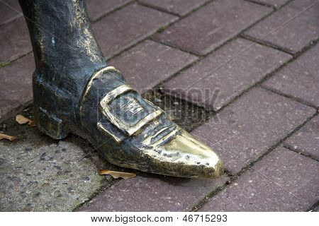 Foot In The Shoe Statue.
